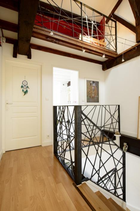 garde-corps intérieur maison en acier brut cirée à motif design